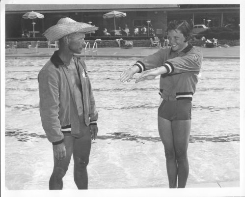 man and girl at pool.