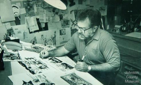 Photo of cartoonist Bob Bliss in his studio