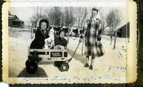 photo of children and dog in wagon