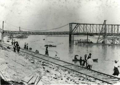 1903 Flood of Kansas River at 12th Street Bridge. Sightseers along Kansas River at 12th Street Bridge.