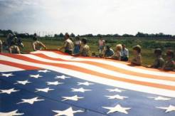 Boy Scouts with Flag, Lenexa Community Days Parade, 1985. Original: http://www.jocohistory.org/cdm/ref/collection/lhs/id/1626