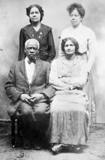 David Page and his family circa 1930.  Page (1841-1938) was born into slavery in Virginia.  He fought in the Civil War and settled in Olathe, where he ran a laundry business out of his home.