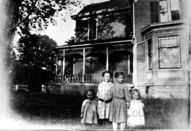 Girls in front of the Philip Reinhardt home, 1913 Fred Reinhardt's daughters Mildred Aileen and Florence are on the left. Original image: http://www.jocohistory.org/cdm/ref/collection/jcm/id/1436