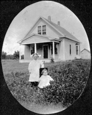 Fred Reinhardt house, 1911 Fred's daughters Florence and Mildred Aileen are pictured. Original image: http://www.jocohistory.org/cdm/ref/collection/jcm/id/1238