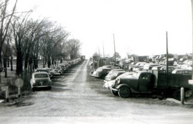 Vehicles parked at the Wolverine Dairy farm for livestock sale, 1952.  Original: http://www.jocohistory.org/cdm/ref/collection/jcm/id/15042