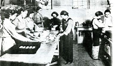 Women cooking at the NYA camp in Zarah.  Kansas City Star, April 18, 1937.