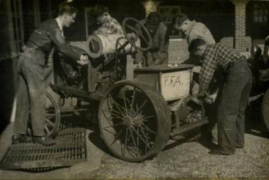 Boys taking apart a tractor. Photo taken from a FFA Scrapbook, ca. 1939-40. Source: JoCoHistory.org.