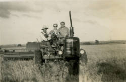 Farmall tractor, ca. 1943. Hazel Sharp, Ed Miller and Perry Sharp working in the grain fields. Source: JoCoHistory.org.
