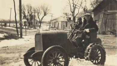 Floyd Moon and Edwin Rice take a tractor out in the snow, ca. 1925. Source: JoCoHistory.org.
