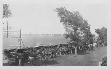 Horse drawn buggies lined the perimeter of the Pleasant Valley Cemetery during the service for the tornado victims, ca. 1917. Source: JoCoHistory.org.