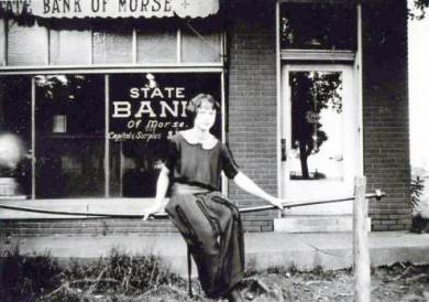 Woman in front of State Bank of Morse. Source: JoCoHistory.org.