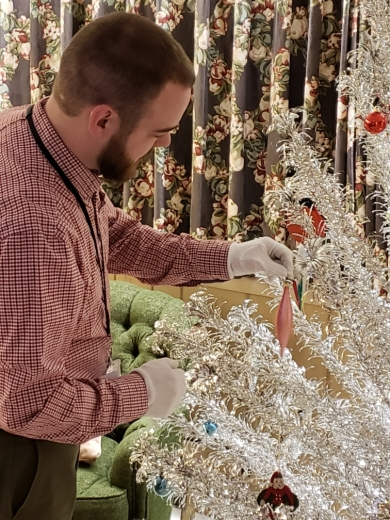 Johnson County Museum staff decorating the Evergleam aluminum Christmas tree.