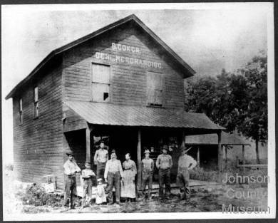 Coker family on porch of store