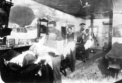 Ferby Barbershop, Olathe, c. 1909. Located at 140 N. Cherry St.