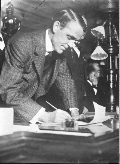 "Kansas Governor Arthur Capper signing the 1917 ""Bone Dry"" Law. Image courtesy Kansas State Historical Society."