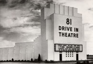 81 Drive in Theatre building showing The Hurricane on a marquee.
