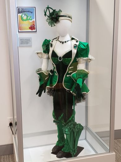 This costume was worn by a resident of the Emerald City in the 1995 U.S. Tour production of the Wizard of Oz Broadway musical.