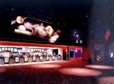 Concession stand with space mural above it at the WestGlen 12.
