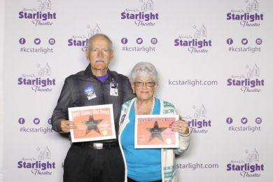 Jan and Lee Morevitska holding their volunteer service awards