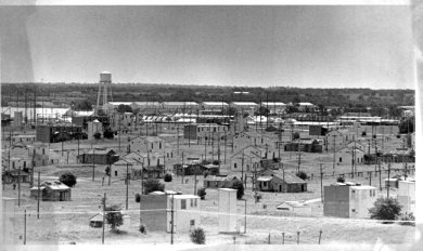 Sunflower AAP in 1991, near the end of its production life. Multi-story structures and one of the four large water towers are visible. The water towers still stand, visible to the south from K-10. Johnson County Museum.