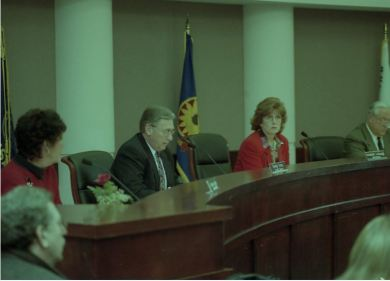 Johnson County Board of County Commissioners debating the prospects of the Wonderful World of Oz theme park in 2000. [Sun Newspaper Coll., Johnson County Museum]