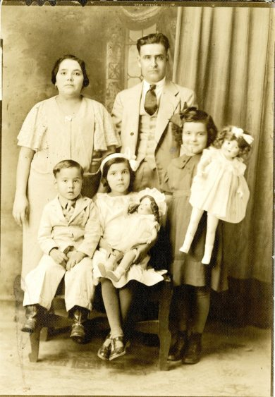 1-This photograph shows Eladio and Luz Valdez with four of their eight children. It was taken in the Kansas City area before 1938, when Jesse Valdez's father was born.