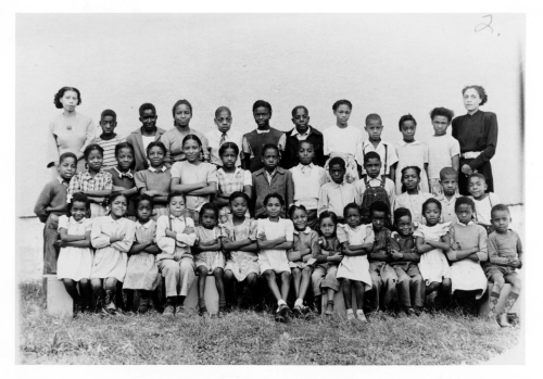 African American students and teachers who walked out of the Walker School, in South Park (Merriam), Kansas, in 1949. Johnson County Museum.