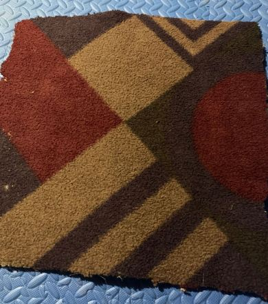 A square of geometrically patterned carpet.