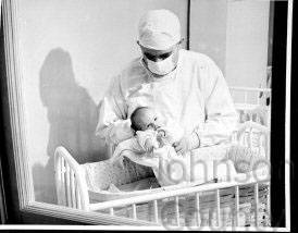 Dr. Reece with Reece Hospital's first birth, Opal Sawyer, born in 1941. To read more about Dr. Reece and his efforts to bring health care to southern Johnson County, see the museum's former newsletter, The ALBUM. Johnson County Museum.