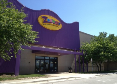 Outside entrance to Zonkers. A purple awning with each letter in Zonkers a different color.
