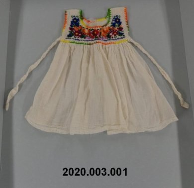 This doll dress from Mexico was one of the few items the donor brought with her when her family immigrated. The Museum accepted it as part of the Latino Collecting Initiative.