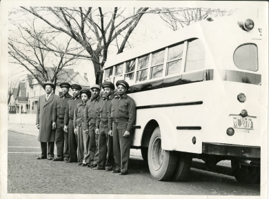 The R.L. McCallop Bus Company operated for 39 years in Johnson County. Pictured from left are: S.H. Thompson, supervisor of Kansas City, Kansas Public Schools; Robert Lee McCallop, Sr., bus company owner; William Jesse McCallop, driver; Mrs. Charlene McCallop (Charles' wife), driver; Robert Lee McCallop, Jr., driver; Alexander Harrison McCallop, driver; and Charles Eugene McCallop, driver.