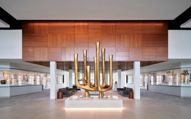 The synagogue entry and gathering hall at Temple B'nai Jehudah, built in 2000, with the Klein Collection display in the background on the left and right. Learn more about the Michael Klein Collection: https://www.flatlandkc.org/commentary/a-lifetime-collection-of-jewish-artifacts-finds-a-home/ Image courtesy of Temple B'nai Jehudah.
