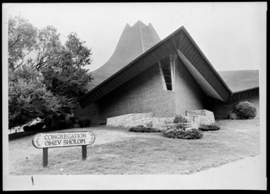 Congregation Ohev Sholom built its first synagogue in Johnson County—a modernist, tent-like structure—at 75th Street and Nall Avenue in 1963. It still stands today. Johnson County Museum.