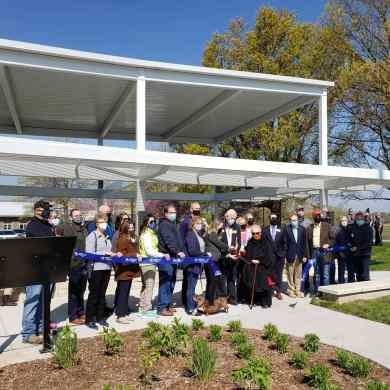 Ribbon cutting on Saturday, April 24, 2021 at the rededicated Barkley Plaza at Shawnee Mission Park. Joan Barkley Wells is seventh from the right.